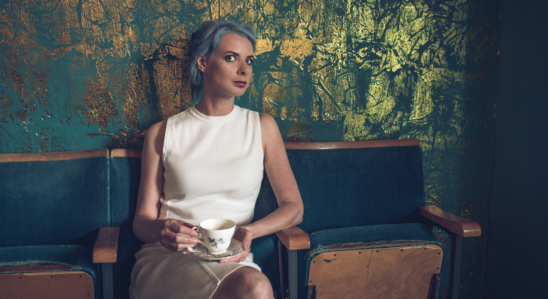 Portrait of woman with tea cup